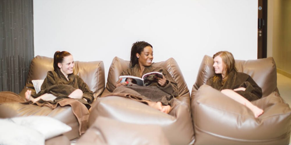 Ladies relaxing on soft chairs in relaxation area at Abbey Spa