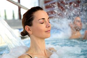 A lady relaxing in the spa pool jets.