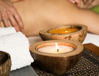 Relaxing scented candle massage