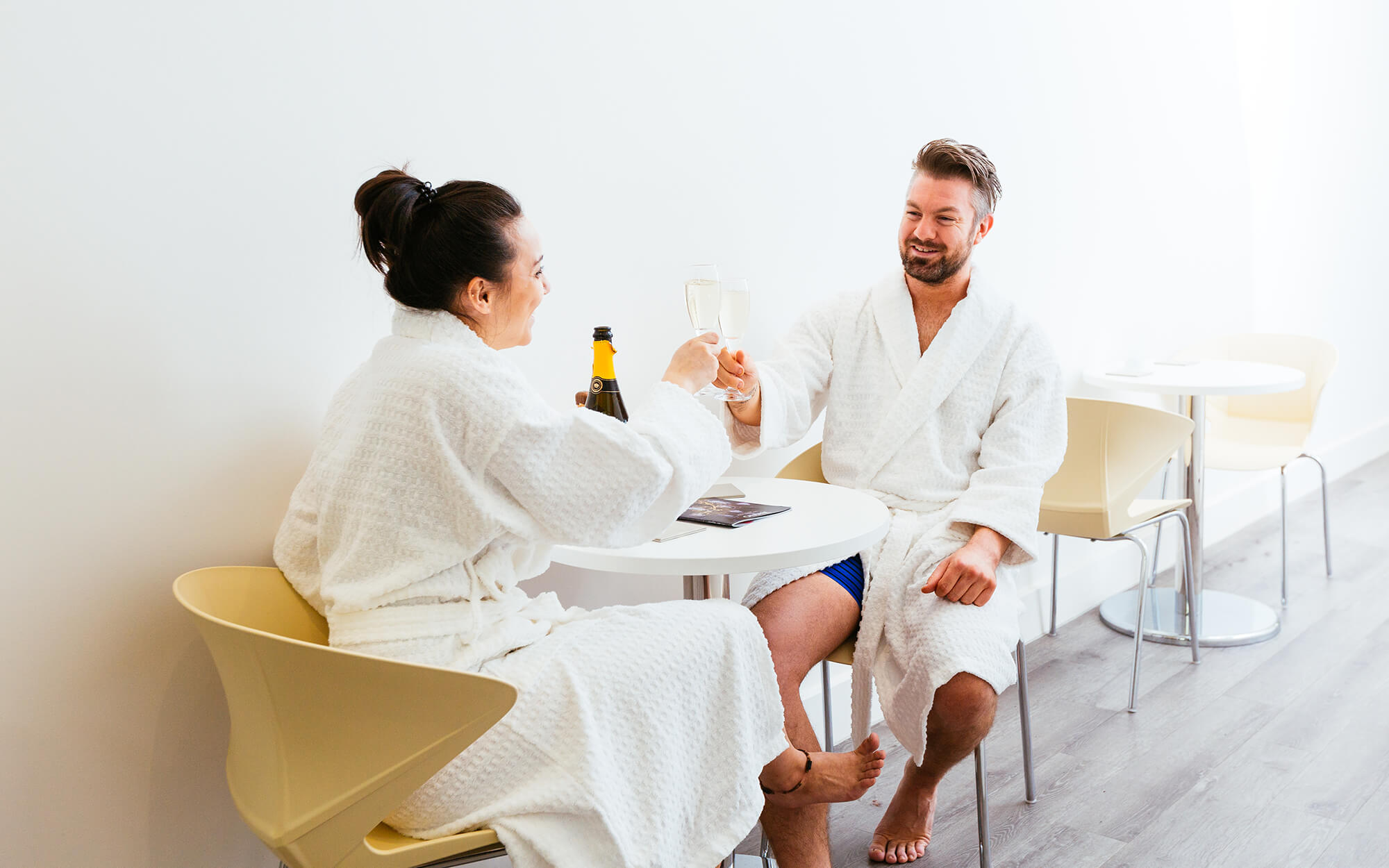 Couple in spa robes relaxing