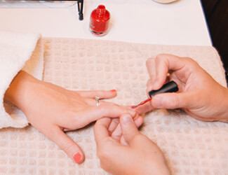 Hand manicure - nails being painted