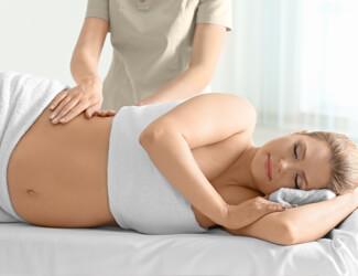 Pregnant lady enjoying relaxing massage.