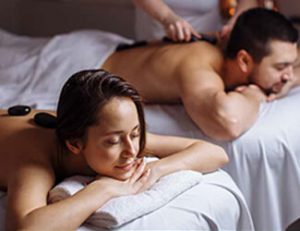 Couple enjoying hot stone massage