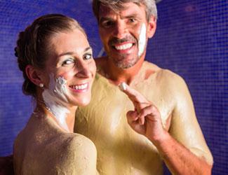 Couple using mud within rasul facility